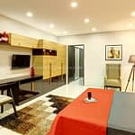 Bedroom-with-matching-wardrobes-study-table-and-queen-size-bed-min